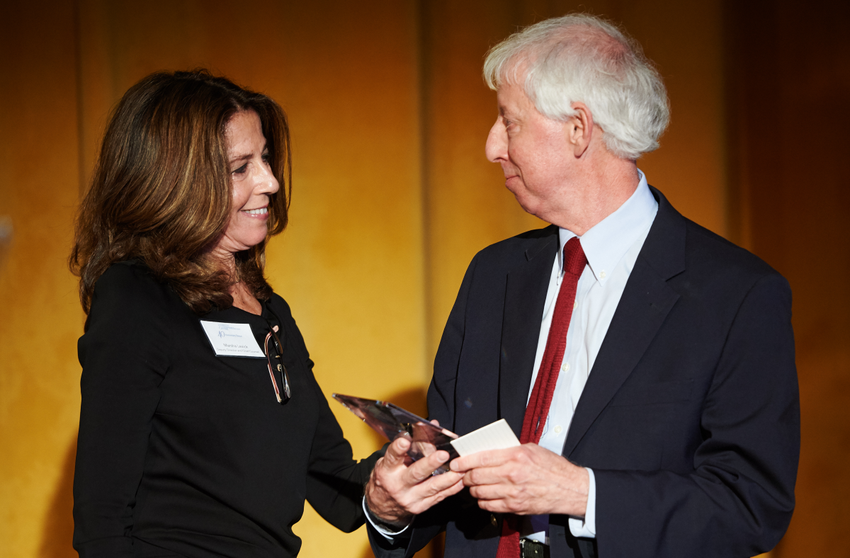 Marsha Levick presenting Bob Schwartz with inaugural Leadership Prize in 2015.