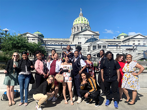 Youth advocates standing outside PA's capitol building.