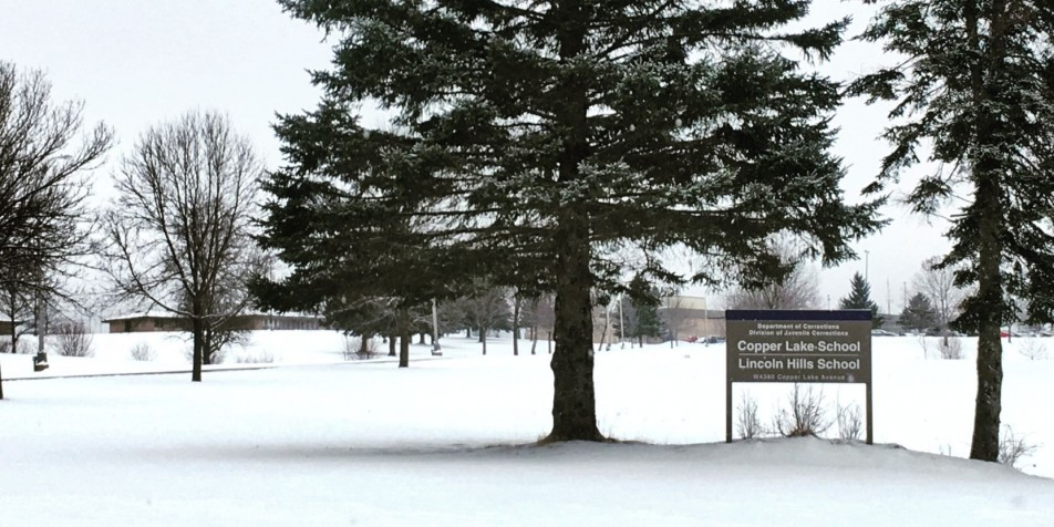 Photo of trees and sign outside Lincoln Hills Juvenile Correctional Facility.