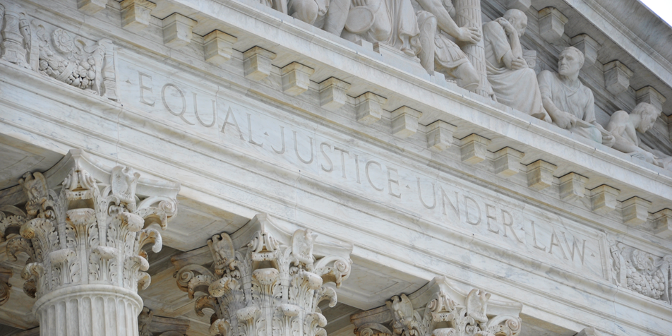 "Photo of SCOTUS building transom reading ""Equal Justice Under Law"""