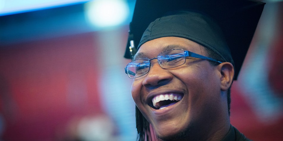 African-American young man in a graduation cap and tassel.