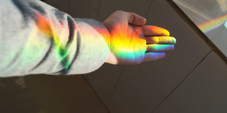 hand catching the light of a rainbow
